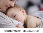 mom breast feeding baby girl | Shutterstock . vector #332360210