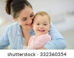 portrait of mother cuddling her ... | Shutterstock . vector #332360354
