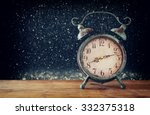 image of vintage alarm clock on ... | Shutterstock . vector #332375318