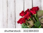 Stock photo bouquet of red roses on a light wooden background top view 332384303