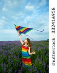 Young Woman In A Rainbow Dress...
