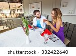 couple drinking tea at cafe | Shutterstock . vector #332422640