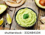 Avocado Hummus On A Dark Wood...