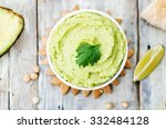 Avocado Hummus On A White Wood...