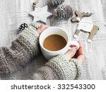 holding chocolate mug on... | Shutterstock . vector #332543300