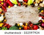 frame of various vegetables... | Shutterstock . vector #332597924