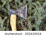 axe on cut down spruce branches | Shutterstock . vector #332610416