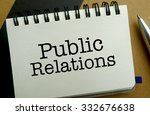 Public relations memo written on a notebook with pen - stock photo