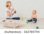 beautiful girl blows bubbles to ... | Shutterstock . vector #332785754