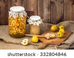 Small photo of Quince preserves in a wooden pantry.