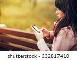 young woman text messaging | Shutterstock . vector #332817410