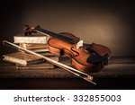 Violin  Bow And Old Books On A...