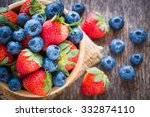 Blueberries And Strawberry In...