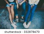 Feet Of Three Friends Sitting...