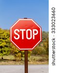 stop sign on an autumn trees... | Shutterstock . vector #333023660