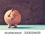 an earthenware piggy bank with... | Shutterstock . vector #333024650