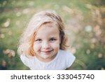 portrait of a little blond girl ... | Shutterstock . vector #333045740