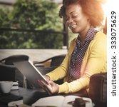 african woman using tablet... | Shutterstock . vector #333075629