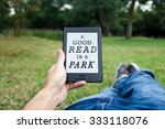 reading in park. | Shutterstock . vector #333118076