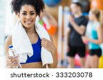 fit woman smiling at camera at... | Shutterstock . vector #333203078