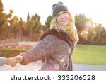 happy young woman pulling... | Shutterstock . vector #333206528