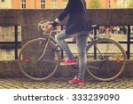 young girl with old bicycle. | Shutterstock . vector #333239090