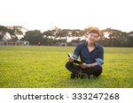 young male student reads a book ...   Shutterstock . vector #333247268