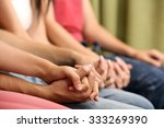 young people holding hands... | Shutterstock . vector #333269390