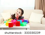 little girl playing with cubes... | Shutterstock . vector #333330239