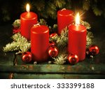 Small photo of Xmas Advent wreath with two lighted candles for the 4th advent sunday rustic christmas traditional concept