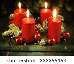 Small photo of Xmas Advent wreath with four lighted candles for the 4th advent sunday rustic christmas traditional concept