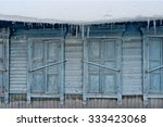 icicles hang from a roof of the ... | Shutterstock . vector #333423068