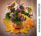 Autumn Dried Flowers In Pumpki...