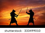 Silhouette Of Two Samurais In...