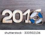 figures 2016 on old grey wooden ... | Shutterstock . vector #333502136