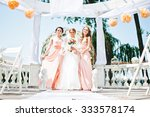 bride with bridesmaid at... | Shutterstock . vector #333578174