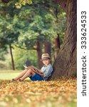 boy with book sitting under big ... | Shutterstock . vector #333624533