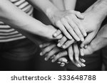 united hands close up.  black... | Shutterstock . vector #333648788