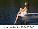 relaxing young woman on wooden... | Shutterstock . vector #333679760