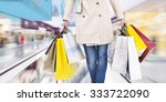 woman walking with shopping