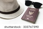 hat sunglasses and passport on...   Shutterstock . vector #333767390