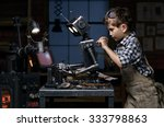 young boy mechanic repairing... | Shutterstock . vector #333798863