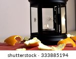 lantern lit with orange peel | Shutterstock . vector #333885194