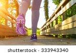 fitness girl running in a field ... | Shutterstock . vector #333943340