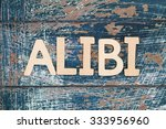Small photo of Word alibi written with wooden letters on rustic surface