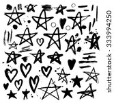 set of hand drawn stars and...