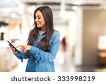 happy young woman with tablet | Shutterstock . vector #333998219