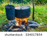 touristic cooking set on a fire | Shutterstock . vector #334017854