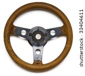 An Old Steering Wheel On White...