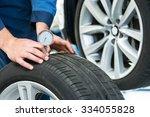 mechanic  pressing a gauge into ... | Shutterstock . vector #334055828
